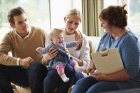 depositphotos 50476699-stock-photo-social-worker-visiting-family-with